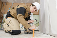Woman using hammer and chisel. Woman using a hammer and chisel royalty free stock photo