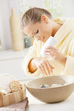 Woman using hand cream Stock Image