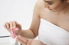 Woman using hand cream Royalty Free Stock Image