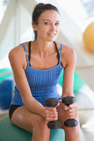 Woman Using Hand Weights On Swiss Ball At Gym Royalty Free Stock Photos