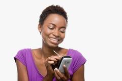 Woman using handheld computer Royalty Free Stock Photography