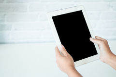 Woman using Hands touching. On a blank screen on modern tablet phone screen Royalty Free Stock Photo
