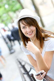 Woman using handsfree device Stock Photos