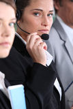 Woman using headset Royalty Free Stock Image