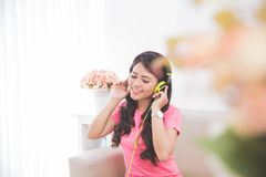 Woman using a headset Royalty Free Stock Photos