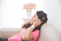 Woman using a headset Royalty Free Stock Image