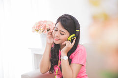Woman using a headset Royalty Free Stock Photography