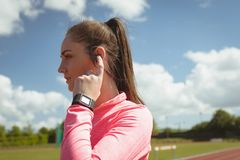 Woman using her bluetooth headest Stock Images