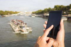 Woman using her cell phone, background Paris Stock Photography