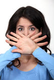 Woman hiding her mouth Stock Photo