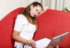 Woman using her laptop Stock Photography
