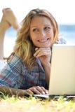Woman using her laptop Royalty Free Stock Photos