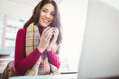 Woman using her laptop and drinking coffee Royalty Free Stock Photos