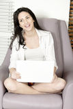 Woman using her laptop at home Royalty Free Stock Images