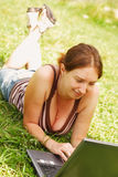 Woman using her laptop outdoors. Young woman using her laptop outdoors Stock Images