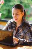 Woman using her laptop outdoors. Stock Photography