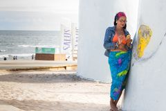 Woman using her mobile at La Mano, Punta Del Este Stock Image