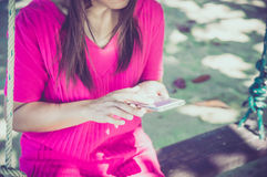 Woman using her Mobile Phone. Royalty Free Stock Image