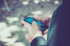 Woman using her Mobile Phone. Royalty Free Stock Images