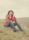 Woman using her mobile phone outdoors Royalty Free Stock Photography