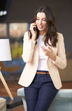 Woman using her mobile phone Royalty Free Stock Image