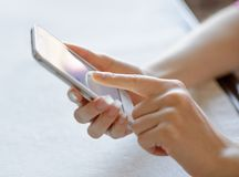 Woman Using Her Mobile Smart Phone at Home Royalty Free Stock Images