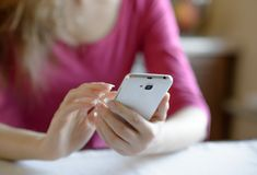 Woman Using Her Mobile Smart Phone at Home Stock Photo