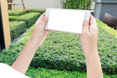 Woman using her mobile smart phone outdoors park Royalty Free Stock Photo