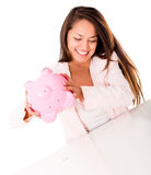 Woman using her savings Royalty Free Stock Image