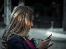 Woman Using Her Smartphone Stock Images