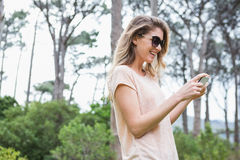 Woman using her smartphone. In the countryside Stock Images