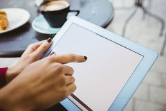 Woman using her tablet Stock Images
