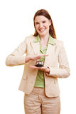 Woman using a hotell bell Stock Photos