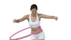 Woman using a hula hoop Royalty Free Stock Photography