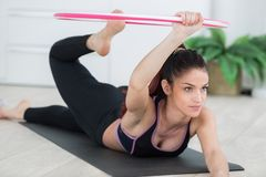Woman using hula hoop for exercise routine Stock Images