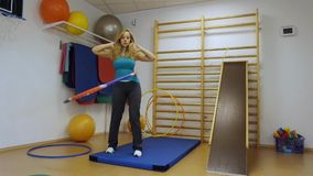 Woman using a hula hoop stock video