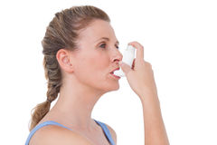 Woman using inhaler for asthma Royalty Free Stock Images