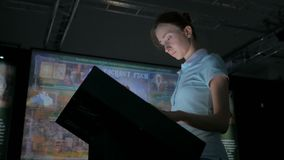 Woman using interactive touchscreen display at modern history museum. Woman using interactive touchscreen display with at modern history museum. Education and stock video footage