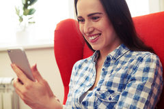 Woman using interesting app on the phone Royalty Free Stock Photos