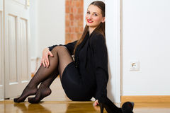 Woman using Internet for online Dating. Online Dating - Young businesswoman sitting at home on the floor while using a tablet computer for online dating Royalty Free Stock Photos