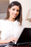 Woman using laptop Royalty Free Stock Photos