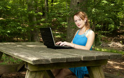 Woman Using Laptop Stock Photography