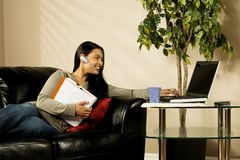 A Woman Using A Laptop Royalty Free Stock Photo