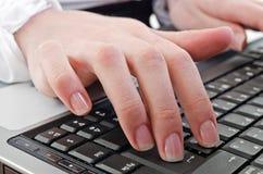 Woman using laptop Royalty Free Stock Photos