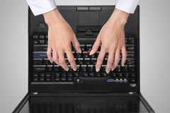 Woman Using Laptop. A woman typing on the laptop computer Stock Photos