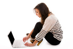 Woman using a laptop Stock Photography