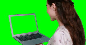Woman using laptop. Against green screen stock video