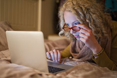 Woman using laptop in bed at night 003 Royalty Free Stock Photo