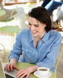 Woman Using Laptop In Cafe Stock Photography