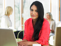 Woman Using Laptop In Cafe Royalty Free Stock Photography